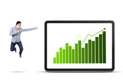 Businessman pointing at the business chart stock photography