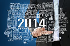 Businessman pointing 2014 business concept. Present by keyword Royalty Free Stock Photos