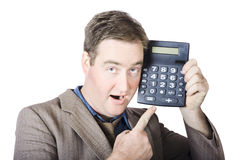 Businessman Pointing At Calculator Royalty Free Stock Photos