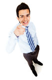 Businessman pointing at the camera Stock Photos
