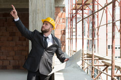 Businessman Pointing On Ceiling Royalty Free Stock Photos