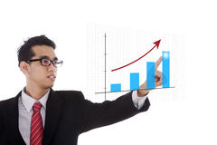 Businessman pointing at chart Stock Photo