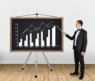 Businessman pointing on chart Stock Photography