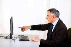 Businessman pointing the computer Royalty Free Stock Photo
