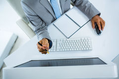Businessman pointing at computer monitor Royalty Free Stock Images