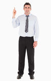Businessman pointing at copy space Stock Image