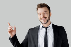 Businessman pointing copy space. Royalty Free Stock Photography