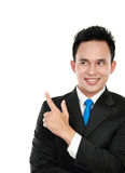 Businessman pointing on the copyspace Stock Photo