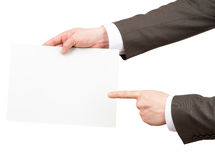 Businessman pointing at empty paper Royalty Free Stock Photos