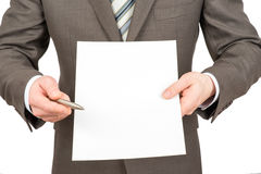 Businessman pointing at empty paper with pen Royalty Free Stock Photo
