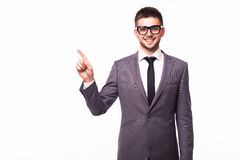 Businessman pointing finger away over gray background Royalty Free Stock Photography