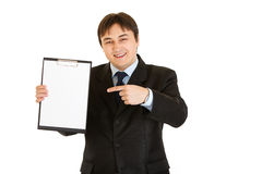 Businessman pointing finger at blank clipboard Royalty Free Stock Image