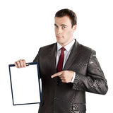 Businessman pointing finger at blank clipboard Stock Photography