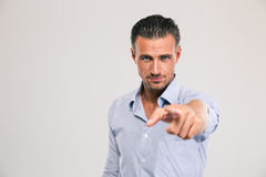 Businessman pointing finger at camera Stock Photo