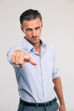 Businessman pointing finger at camera Royalty Free Stock Photos