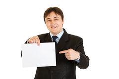 Businessman pointing finger at empty white paper Stock Photos