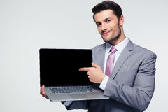 Businessman pointing finger on the laptop screen Stock Photography