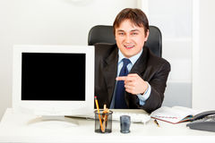 Businessman pointing finger at monitor Stock Photos