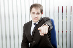 Businessman pointing a finger Stock Images