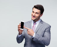 Businessman pointing finger on smartphone screen Stock Image
