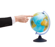 Businessman pointing finger to earth globe Royalty Free Stock Photography