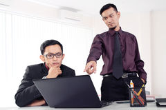 Businessman pointing finger to laptop Royalty Free Stock Images