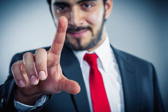 Businessman pointing finger to push. Something you like copyspace Royalty Free Stock Photo