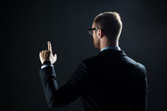 Businessman pointing finger to something invisible Stock Photography