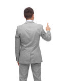 Businessman pointing finger or touching something Stock Photos