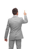Businessman pointing finger or touching something Stock Image