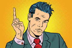 Businessman pointing finger up. Pop art retro vector illustration Stock Photography