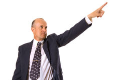 Businessman pointing forward. With his hand. isolated on white Stock Photography