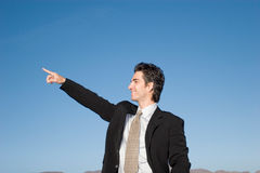 Businessman pointing forward Stock Photo