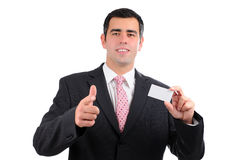 Businessman pointing forward with a business card Stock Images