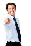 Businessman pointing into frame Royalty Free Stock Image