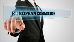 Businessman Pointing Glowing European Commission Stock Photo