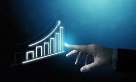 Free Businessman Pointing Graph And Arrow Increase Stock Photo - 217048950
