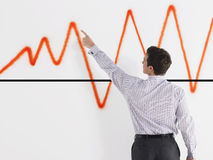 Businessman Pointing At Graph Royalty Free Stock Photos
