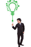 Businessman pointing green ecology light bulb Stock Photos