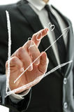 Businessman pointing at graph 2013 Royalty Free Stock Photos