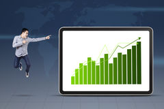 Businessman pointing at growth graph Stock Image