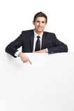 Businessman pointing hand gestures at copy space Royalty Free Stock Photo