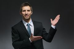 Businessman pointing with hands Stock Photo