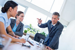 Businessman pointing his colleagues during meeting Stock Images