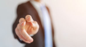 Businessman pointing his finger. Businessman on blurred background pointing his finger Stock Image
