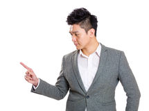 Businessman pointing with his finger Stock Photo