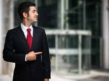 Businessman pointing his finger to the copyspace. Smiling businessman pointing his finger to the copyspace Stock Image