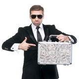 Businessman pointing his finger towards metal suitcase Stock Photo