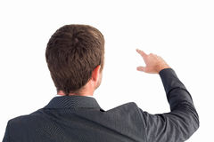 Businessman pointing with his finger Royalty Free Stock Images