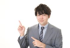 Smiling Asian businessman. Businessman pointing with his fingers isolated on white background stock photos